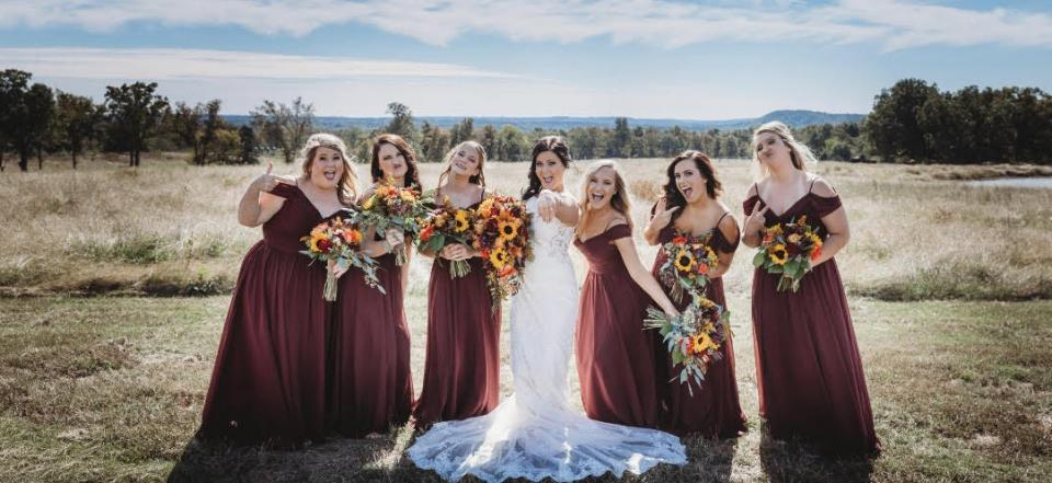 Hannah's flower selection and bridesmaid dress color complimented the fall foliage and pasture.